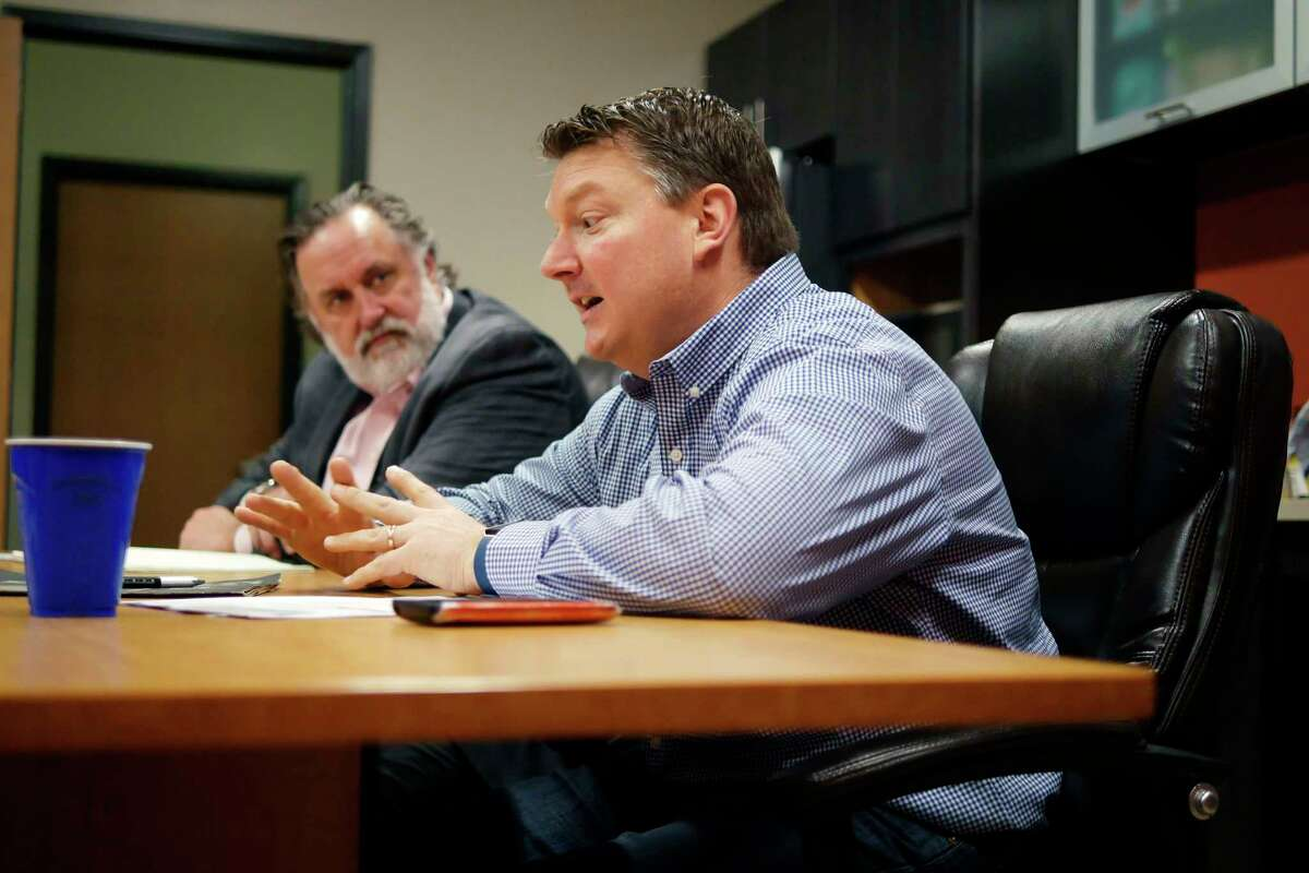 Marty Vanags, left, president of Saratoga County Prosperity Partnership, with a Saratoga County business owner on Thursday, April 6, 2017, in Waterford, N.Y. (Paul Buckowski / Times Union)