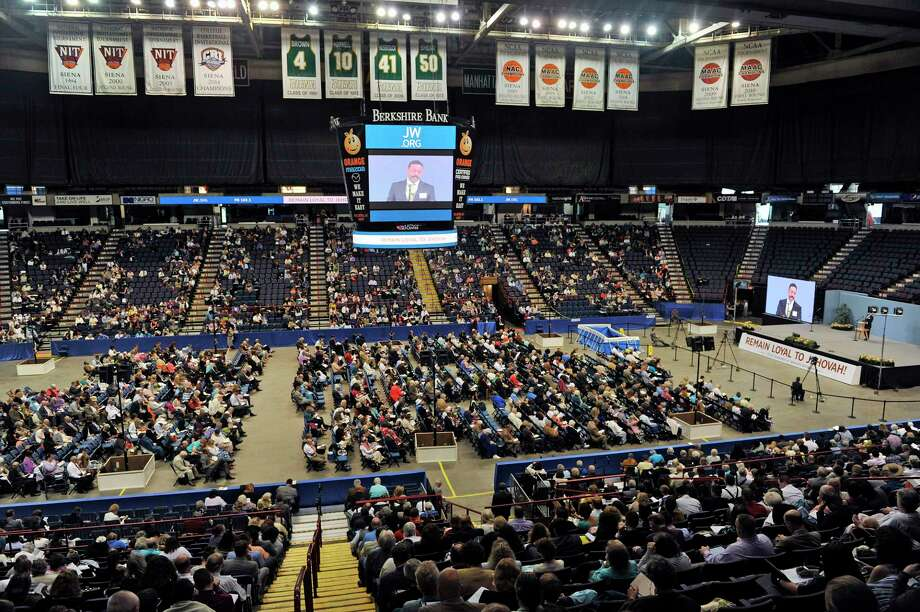 Members of Jehovah's Witnesses congregations from the region attend the Remain Loyal to Jehovah, Regional JehovahOs Witnesses Convention at the Times Union Center on Sunday, July 10, 2016, in Albany, N.Y.  Hans Hollis, regional media contact for the Convention, said that this yearOs convention message is how to strengthen resolve to be loyal to what you believe.  OThroughout the weekend there are talks based on specific examples taken out of the Bible to highlight people who had the resolve to do what is right under difficult circumstancesO, Hollis said.  Hundreds of volunteers put on the convention and this year there are 39 video presentations and 2 movies shown during the convention.  The convention was held Friday through Sunday for members of half of the regional congregations and next Friday anther convention begins running through Sunday for the members of the other roughly 40 congregations.  The public is welcome to attend the convention which runs from 9:20am to 5:00pm each day.  about 4,000 Jehovah Witnesses attended this weekendOs convention.  OThis is the first time in 20 years weOve held the convention in Albany, we have an assembly hall in Newburgh but we outgrew it for our conventionO, Hollis said.  On Saturday 20 new members took part in a full immersion baptism ceremony and the baptisms will take place again on Saturday.   (Paul Buckowski / Times Union) Photo: PAUL BUCKOWSKI / 20037231A