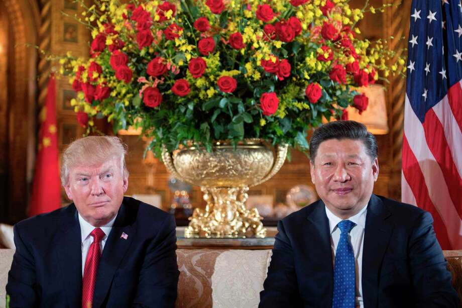 "(FILES) This file photo taken on April 6, 2017 shows US President Donald Trump (L) with Chinese President Xi Jinping (R) during a bilateral meeting at the Mar-a-Lago estate in West Palm Beach, Florida. US President Donald Trump said April 11, 2017 that the United States is ready to solve the North Korean ""problem"" without China if necessary.""North Korea is looking for trouble,"" Trump wrote on Twitter. ""If China decides to help, that would be great. If not, we will solve the problem without them! U.S.A.""  / AFP PHOTO / JIM WATSONJIM WATSON/AFP/Getty Images Photo: JIM WATSON, Staff / AFP or licensors"