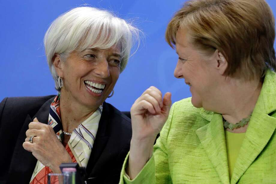 Christine Lagarde, left, of the International Monetary Fund, confers with German Chancellor Angela Merkel earlier this week. Photo: Michael Sohn, STF / Copyright 2017 The Associated Press. All rights reserved.