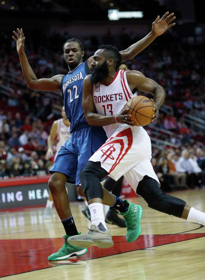 It's full speed ahead for James Harden as he drives past Timberwolves forward Andrew Wiggins on Wednesday night at Toyota Center. The history-making Harden led the Rockets to their 55th victory in the regular-season finale. Photo: Karen Warren, Staff Photographer / 2017 Houston Chronicle