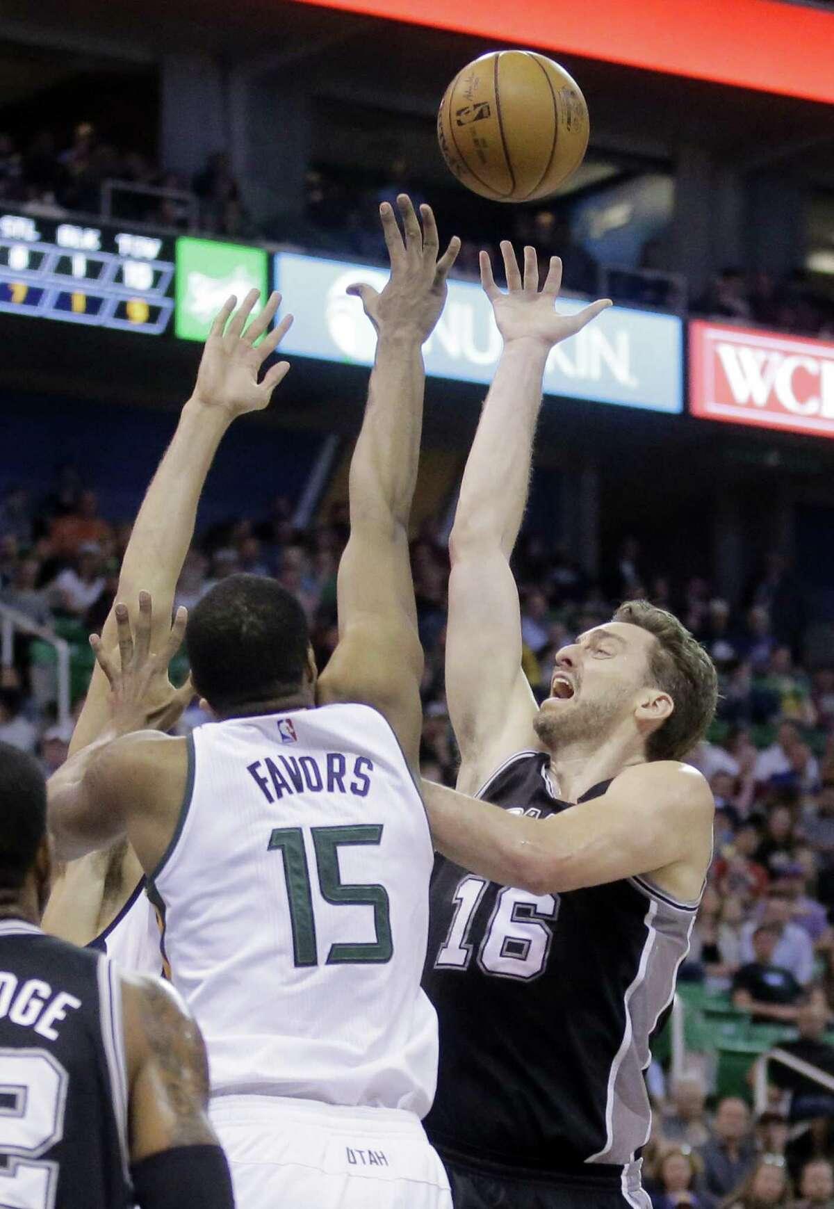 Spurs center Pau Gasol (16) shoots as Utah Jazz forward Derrick Favors (15) defends during the first half on April 12, 2017, in Salt Lake City.