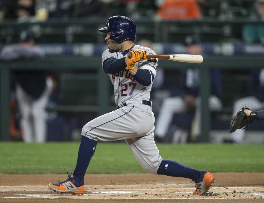 SEATTLE, WA - APRIL 12:  Jose Altuve #27 of the Houston Astros hits a single off of starting pitcher Yovani Gallardo of the Seattle Mariners during the first inning of a game at Safeco Field on April 12, 2017 in Seattle, Washington. (Photo by Stephen Brashear/Getty Images) Photo: Stephen Brashear/Getty Images