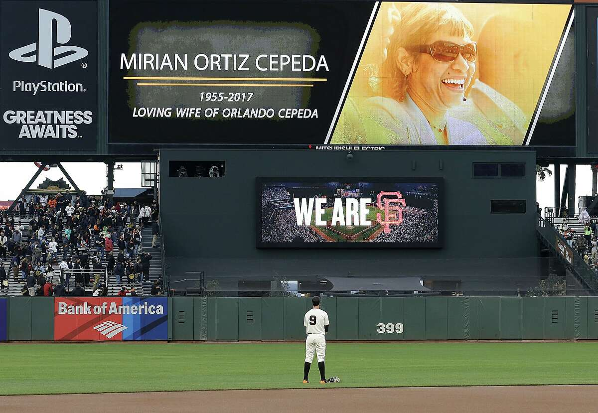 San Francisco Giants first baseman Brandon Belt (9) observes a moment of silence for Mirian Ortiz Cepeda, the wife of former Giants player Orlando Cepeda, before a baseball game between the Giants and the Arizona Diamondbacks in San Francisco, Wednesday, April 12, 2017. (AP Photo/Jeff Chiu)