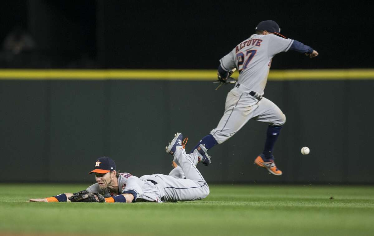 SEATTLE, WA - APRIL 12: Rightfielder Josh Reddick #22 of the Houston Astros dives and Jose Altuve #27 gives chase for a ball off the bat of Mike Zunino of the Seattle Mariners during the sixth inning of a game at Safeco Field on April 12, 2017 in Seattle, Washington. At right is second baseman Jose Altuve #27 of the Houston Astros. (Photo by Stephen Brashear/Getty Images)
