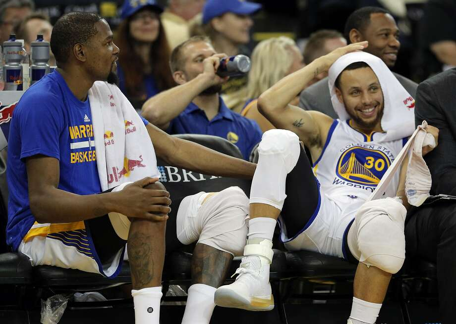 Kevin Durant (35) and Stephen Curry (30) watching the reserves play during