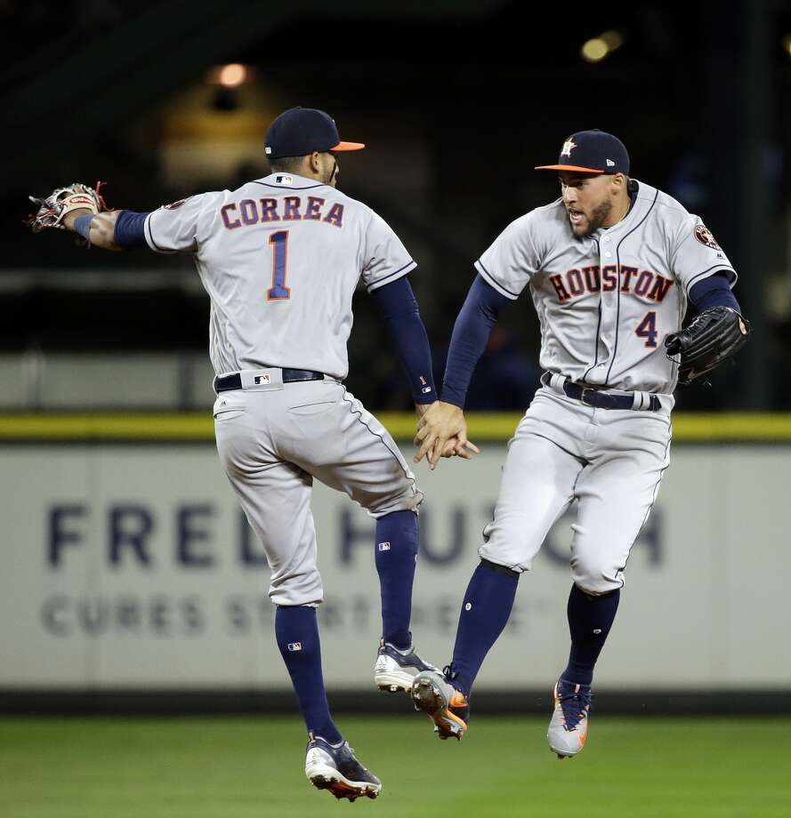 Houston Astros' Carlos Correa (1) and George Springer share congratulations after the team defeated the Seattle Mariners 10-5 in a baseball game Wednesday, April 12, 2017, in Seattle. (AP Photo/Elaine Thompson) Photo: Elaine Thompson/Associated Press