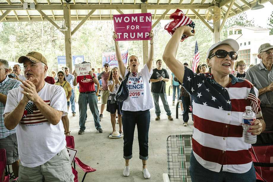 "FILE -- Cheering during the closing remarks at the end of a ""Spirit of America"" rally in Mandeville, a suburb of New Orleans, Feb. 27, 2017. For American voters, party affiliation is a way to express a bundle of identities, even if voting for their party is against their own interests. (William Widmer/The New York Times) Photo: WILLIAM WIDMER, NYT"