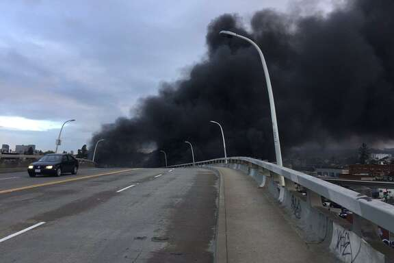 Heavy smoke from a fire that broke out in Oakland Thursday morning caused a slowdown on Interstate-880, officials said.