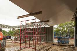 The last signature steel canopy is maneuvered into place at the Menil Drawing Institute.