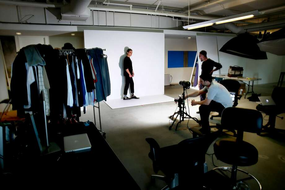 Model Connor Keith (left) works with photographer Mark Fore and stylist Ronald Gravesande during a fashion shoot at the offices of Touch of Modern in San Francisco. The company offers men well-fitting, limited assortment clothes in the most convenient way possible. Photo: Michael Macor, The Chronicle