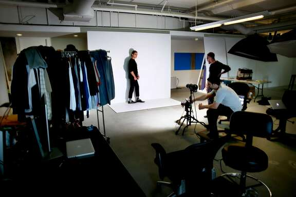 Model Connor Keith, (left) works with photographer Mark Fore and stylist Ronald Gravesande during a fashion shoot at the offices of Touch of Modern on Wed. April 12, 2017, in San Francisco, Calif.