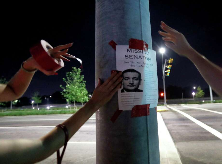"Left-leaning political activists post ""Ted Cruz is missing"" flyers in Houston to draw attention to a town hall meeting scheduled for Saturday at Texas Southern University. Photo: Karen Warren, Staff Photographer / 2017 Houston Chronicle"