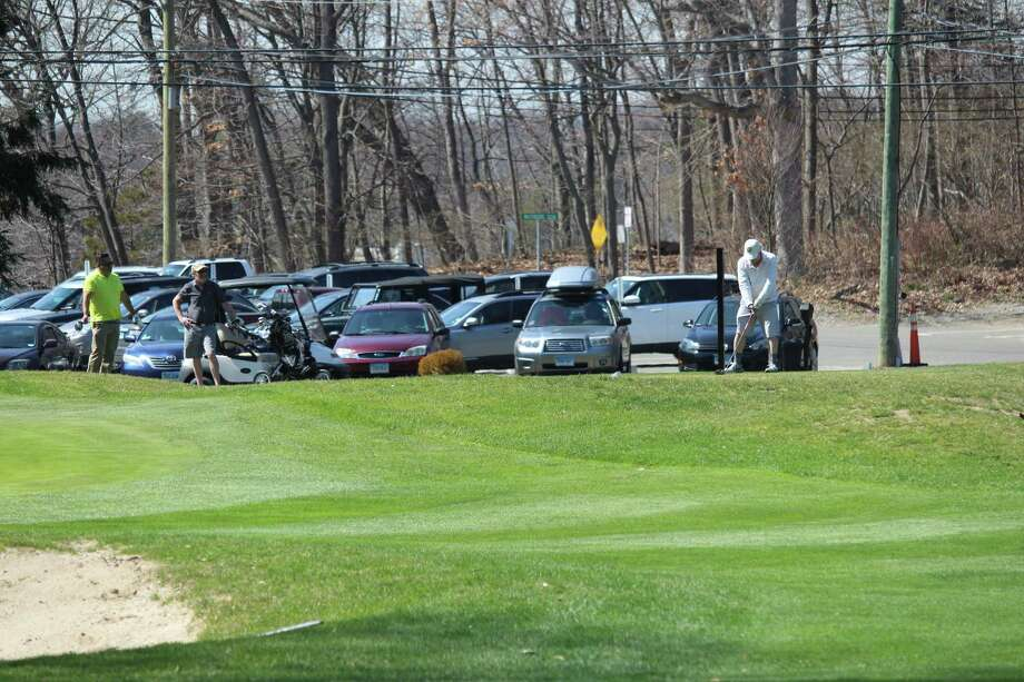 Golfers tee it up at Longshore Golf Course on April 11, 2017. The course opened on April 10. Photo: Chris Marquette / Hearst Connecticut Media / Westport News