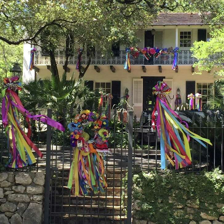 Spring breezes blow colorful Fiesta streamers to and fro from the garlanded balcony to the wrought iron gate posts.