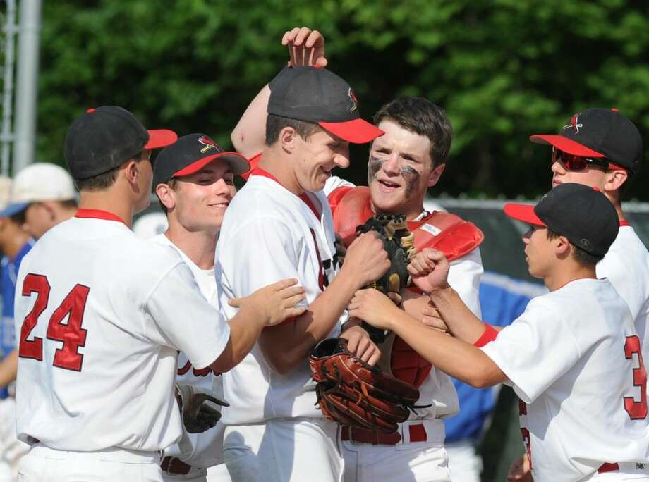 Greenwich High School pitcher, Ryan Carr, center, smiles as he is congratulated by his catcher, Ryan Brennan, and other teammates after pitching for the complete game 3-2 victory over Southington High School in the second round of the Class LL state playoffs, Thursday, June 3, 2010, at GHS.  At left is Michael Dunster, # 24,  and at right is Stephen Monick, # 3. Photo: Bob Luckey / Greenwich Time