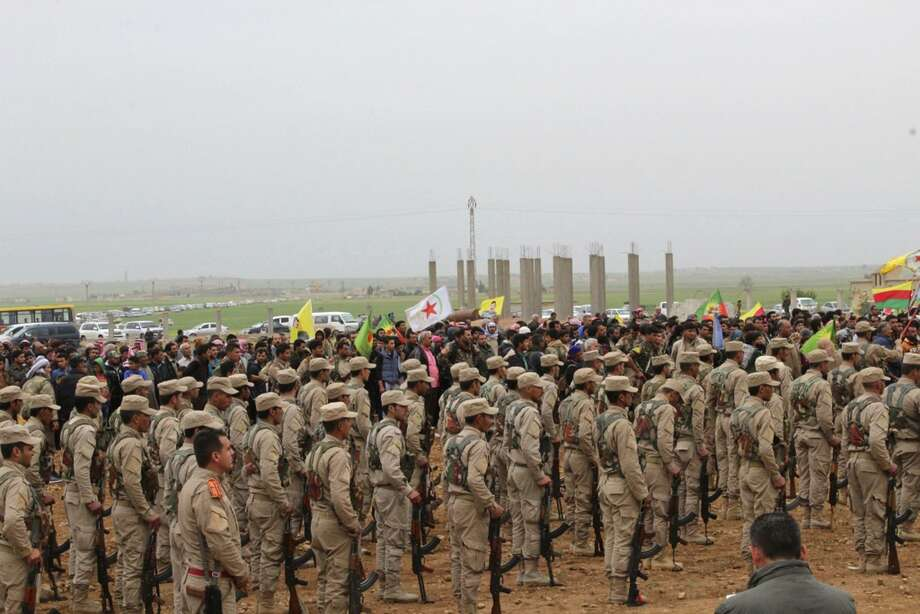 This photo provided by Hawar News Agency, a Kurdish-run news agency, which has been authenticated based on its contents and other AP reporting, shows fighters from the predominantly-Kurdish Syrian Democratic Forces attending  the funeral procession of 18 of their comrades, who were killed Tuesday by a misdirected airstrike by the U.S.-led coalition, in Tal al-Abyad, northeast Syria, Thursday, April 13, 2017. U.S. Central Command said coalition aircraft were given the wrong coordinates by their partner forces, the Syrian Democratic Forces, for a strike intended to target Islamic State militants south of their Tabqa stronghold. (Hawar News Agency via AP) Photo: Uncredited, UGC / Associated Press / Hawar News Agency