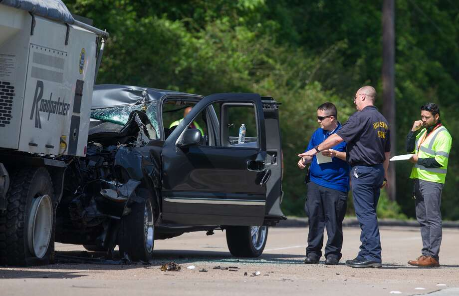 Authorities investigate the scene where a man driving a pickup truck crashed into the back of a City of Houston Public Works vehicle on Will Clayton Parkway Thursday, April 13, 2017, in Humble. The man driving the pickup truck was driving alone and was transported to the hospital with serious injuries, according to Houston Fire Cpt. Dan Sharp. ( Godofredo A. Vasquez / Houston Chronicle ) Photo: Godofredo A. Vasquez, Houston Chronicle