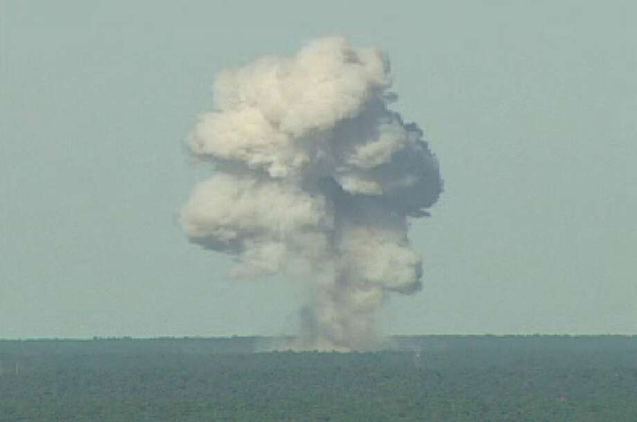 FILE - In this U.S. Air Force handout,  a GBU-43/B bomb, or Massive Ordnance Air Blast (MOAB) bomb, explodes November 21, 2003 at Eglin Air Force Base, Florida. MOAB is a 21,700-pound that was dropped from a plane at 20, 000 feet. Photo: U.S. Air Force