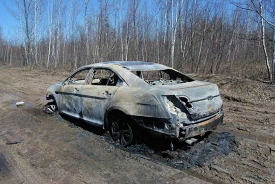 The 2011 Ford Taurus with human remains inside was found in the middle of a seasonal road in the Lame Duck Wildlife Area in Gladwin County's Bourret Township on April 7. Photo provided by the Gladwin County Sheriff's Office.