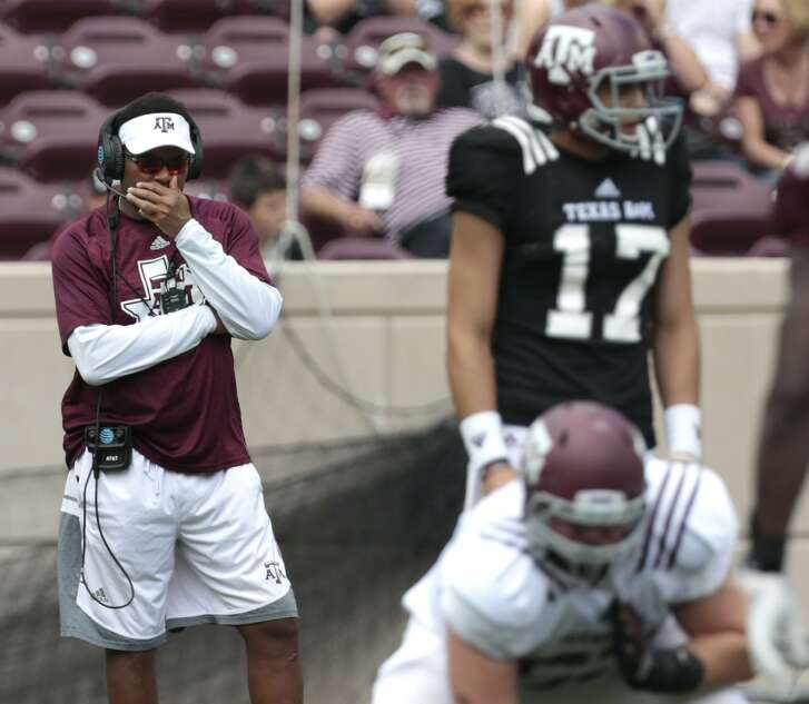 Texas A&M coach Kevin Sumlin watches his offense line up for a play during the spring game at Kyle Field on April 8, 2017, in College Station.