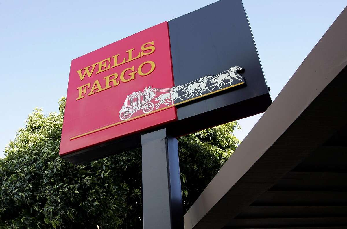 FILE - APRIL 13, 2017: Wells Fargo has reported flat first quarter earnings, reporting a profit of $5.46 billion, or $1 a share, compared to $5.46 billion or 99 cents a share in the same period of last year. SAN FRANCISCO - MARCH 20: The Wells Fargo logo is seen on a sign outside of a Wells Fargo Home Mortgage branch office March 20, 2007 in San Francisco, California. San Francisco based Wells Fargo & Co. announced today that it is cutting over 500 jobs in the home mortgage divisions in South Carolina, Arizona and California that cater to high-risk borrowers. (Photo by Justin Sullivan/Getty Images)