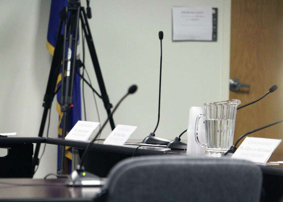 Board members Donna Karnal and Eileen Liu-McCormack left empty seats behind when they walked out of a Board of Education meeting in protest on April 6. Photo: Laura Weiss / Hearst Connecticut Media / Fairfield Citizen