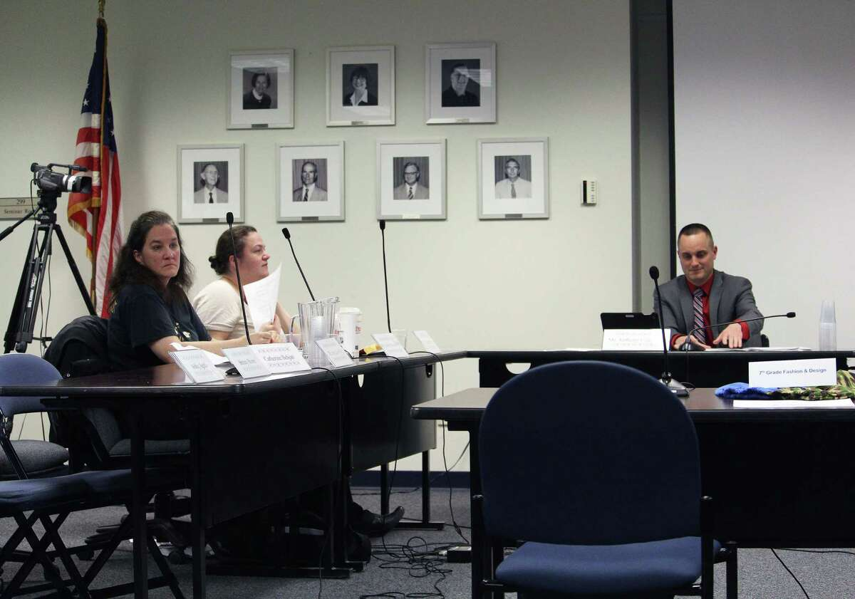 Board members Jennifer Maxon-Kennelly, left, and Trisha Pytko, and Vice Chairman Anthony Calabrese during a Board of Education meeting after several members exited in protest April 6, 2017 in Fairfield, Conn.