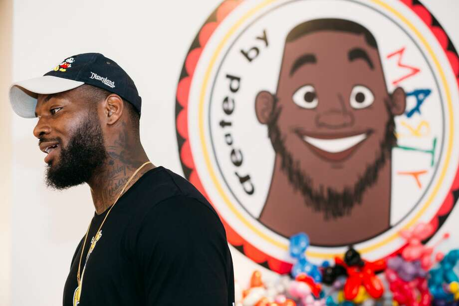 BOSTON, MA - JUNE 17:  Martellus Bennett stands in front of his animated portrait during the Hey AJ Imagination Lounge Pop Up on June 17, 2016 in Boston, Massachusetts.  (Photo by Natasha Moustache/Getty Images for Martellus Bennett- Imagination Agency Pop Up Book Launch) Photo: Natasha Moustache/Getty Images For Martellus Benne
