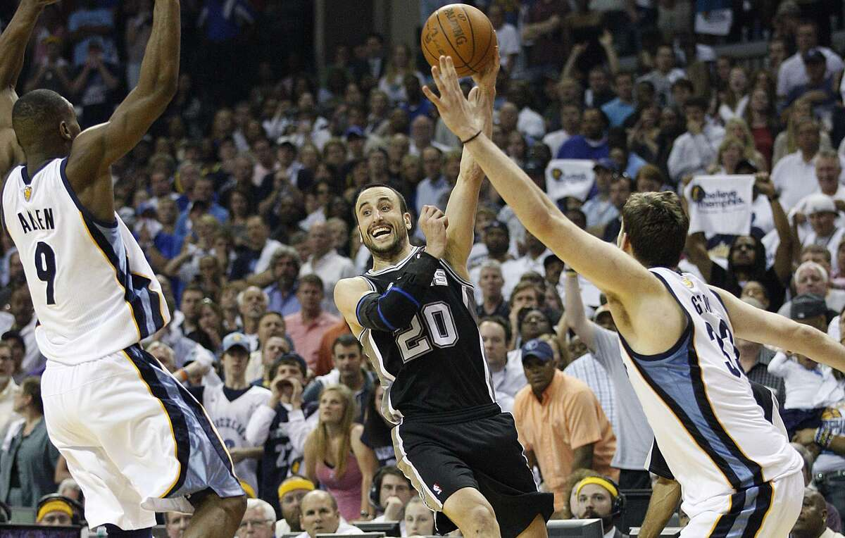 Spurs' Manu Ginobili passes through Memphis Grizzlies Tony Allen and Marc Gasol during second half of Game 6 of the Western Conference first round series at FedExForum on April 29, 2011. The Spurs lost 99-91 and the series 4-2.