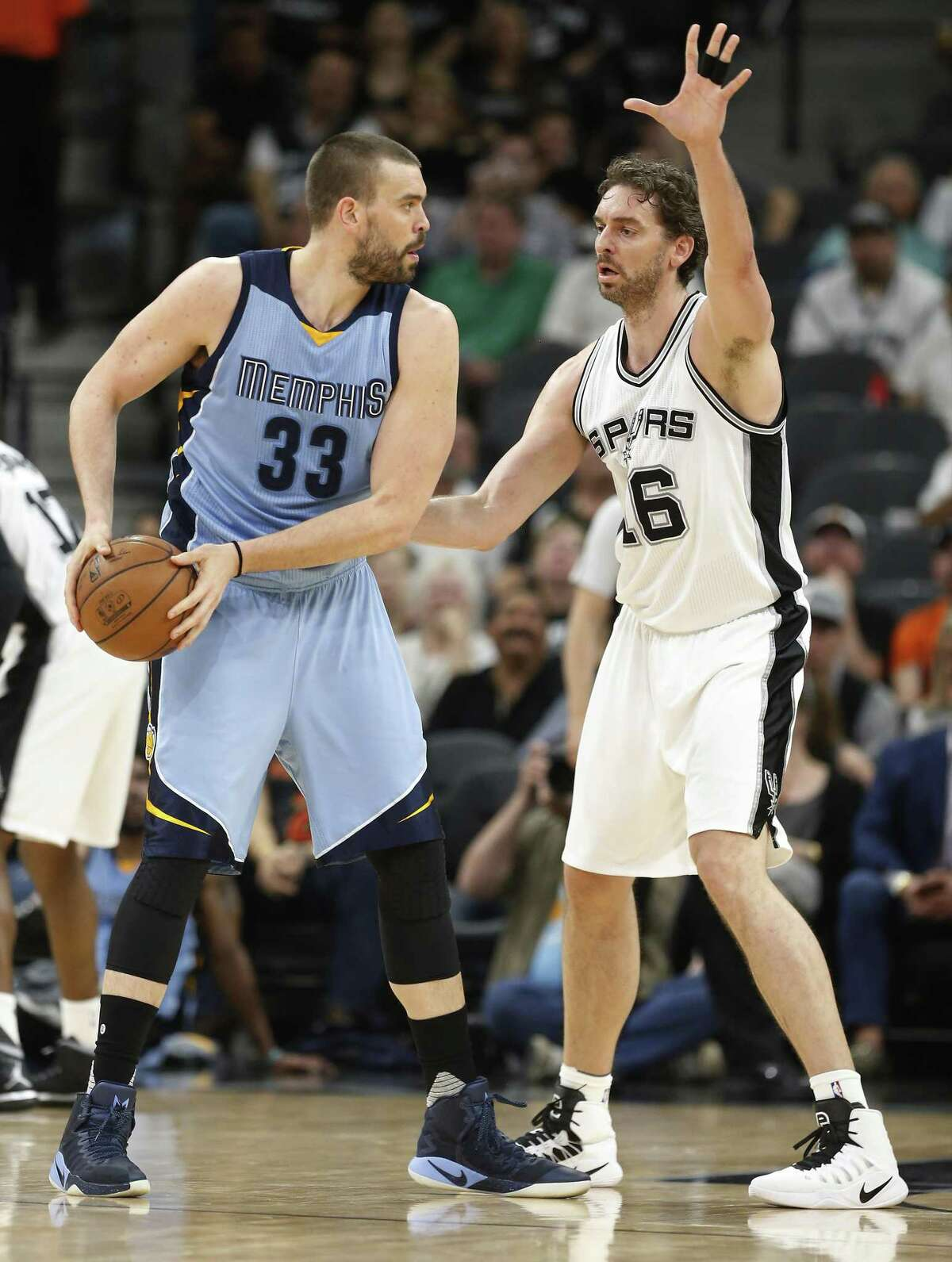 Spurs' Pau Gasol (right) faces off against his brother, the Memphis Grizzlies' Marc Gasol, during their game at the AT&T Center on April 4, 2017.