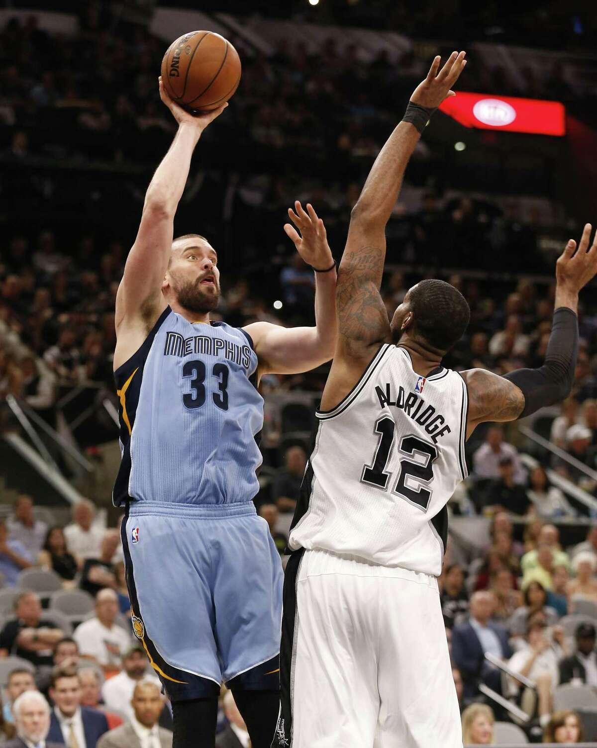 Spurs' LaMarcus Aldridge attempts to defend against the Memphis Grizzlies' Marc Gasol at the AT&T Center on April 4, 2017.