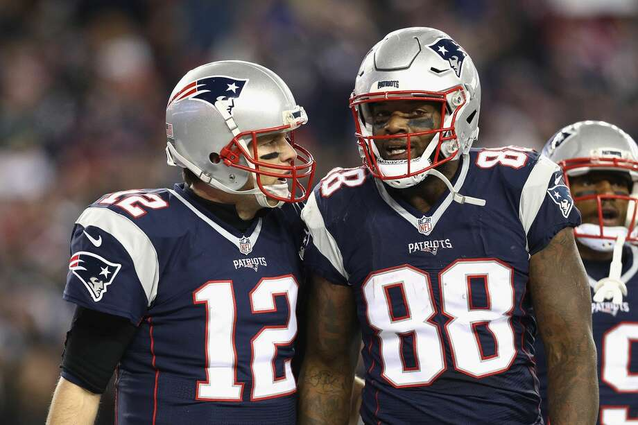 FOXBORO, MA - DECEMBER 12:  Tom Brady #12 of the New England Patriots reacts with Martellus Bennett #88 after scoring a touchdown during the third quarter against the Baltimore Ravens at Gillette Stadium on December 12, 2016 in Foxboro, Massachusetts.  (Photo by Maddie Meyer/Getty Images) Photo: Maddie Meyer/Getty Images