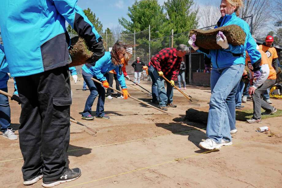 "Volunteers from the Tri-City ValleyCats and their corporate partners, BlueShield of Northeastern New York and Hannaford Supermarkets, take part in the 7th Annual ""4 in 24"" Field Renovation Project on Thursday, April 13, 2017, at the Colonie Little League Pee Wee Field in Cook Park in Colonie, N.Y.  Volunteers worked on four area youth baseball fields and were renovating them in a 24-hour time period.  (Paul Buckowski / Times Union) Photo: PAUL BUCKOWSKI / 20040110A"
