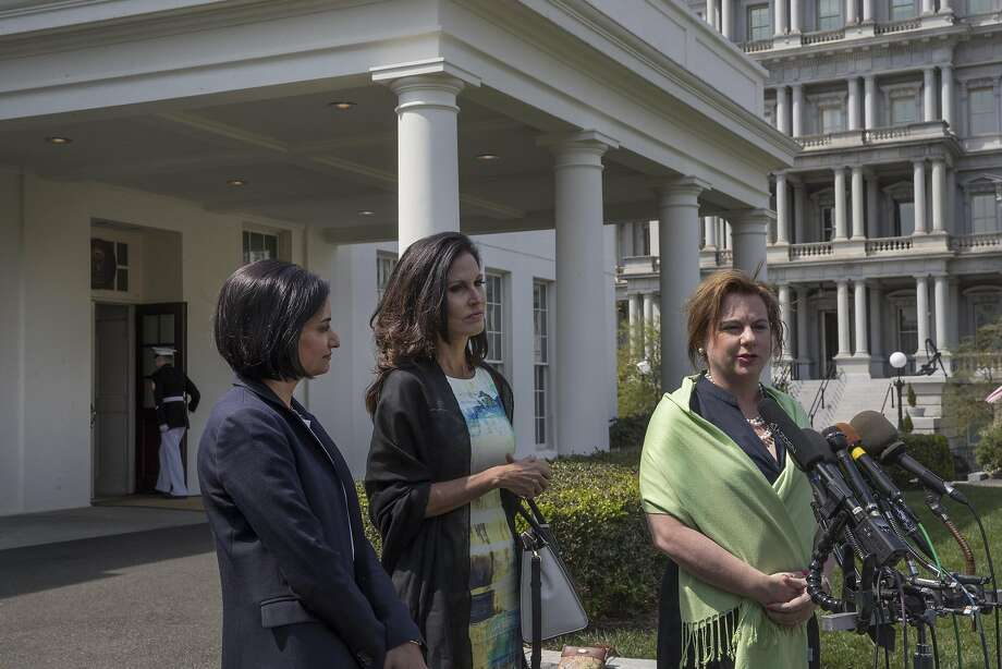 Seema Verma (left), who oversees Medicare and Medicaid, Penny Young Nance and Marjorie Dannenfelser speak in favor of President Trump's action. Photo: STEPHEN CROWLEY, NYT