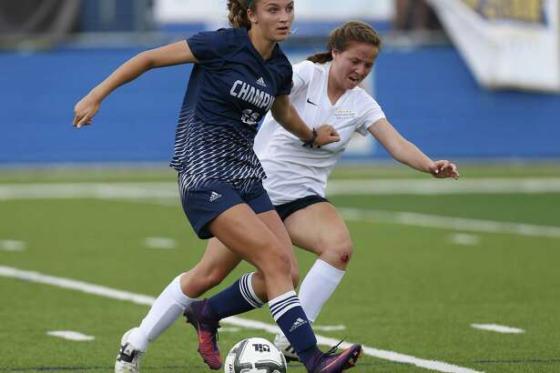 Boerne Champion's Ashlyn Fulgham (12) and Dallas Highland Park's Sarah O'Neal (16) battle for the ball during the UIL soccer class 5A semifinals at Birkelbach Field, Georgetown, Thursday, April. 13, 2017.