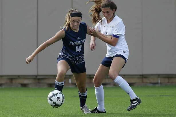 Boerne Champion's Kaitlin Moore (16) and Dallas Highland Park's Anna Robertson (13) battle for the ball during the UIL soccer class 5A semifinals at Birkelbach Field, Georgetown, Thursday, April. 13, 2017. (Stephen Spillman)