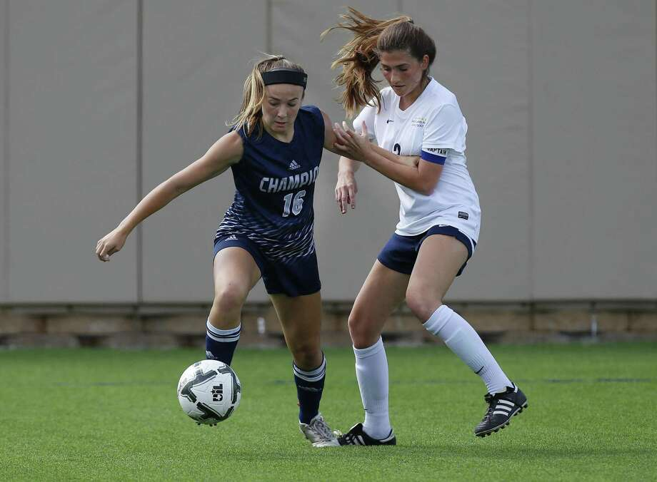 Boerne Champion's Kaitlin Moore (16) and Dallas Highland Park's Anna Robertson (13) battle for the ball during the UIL soccer class 5A semifinals at Birkelbach Field, Georgetown, Thursday, April. 13, 2017. (Stephen Spillman) Photo: Stephen Spillman / Stephen Spillman / stephenspillman@me.com Stephen Spillman