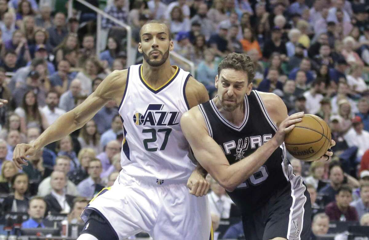 Spurs center Pau Gasol (right) drives around Utah Jazz center Rudy Gobert (27) during the first half on April 12, 2017, in Salt Lake City.