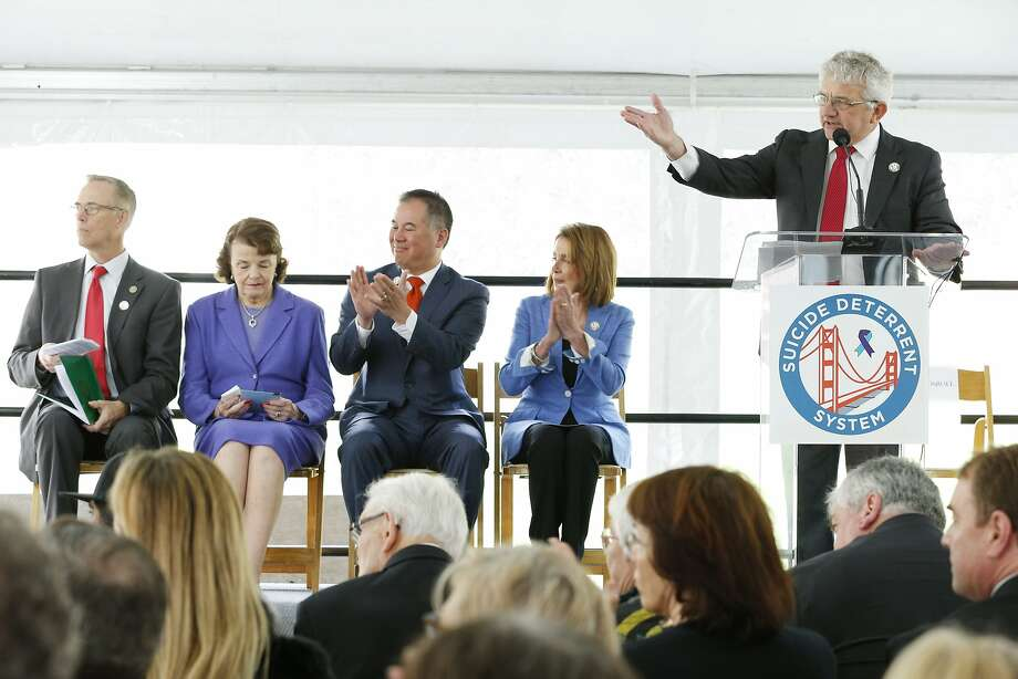 Sen. Dianne Feinstein, D-Calif. (second from left), and Rep. Nancy Pelosi, D-San Francisco (second from right), listen as Dick Grosboil, president of the Suicide Deterrent Advisory Committee, discusses suicide prevention on the Golden Gate Bridge during an April ceremony. Photo: Santiago Mejia, The Chronicle