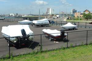 Boats from nearby Bass Pro Shops are currently stored on property for the proposed Seaview Plaza, in Bridgeport, Conn. Aug. 11, 2016.