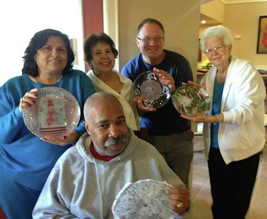 Residents of The Forum at Memorial Woods attend a plate workshop with ARTreach. Photo: Courtesy Of The Forum At Memorial Woods