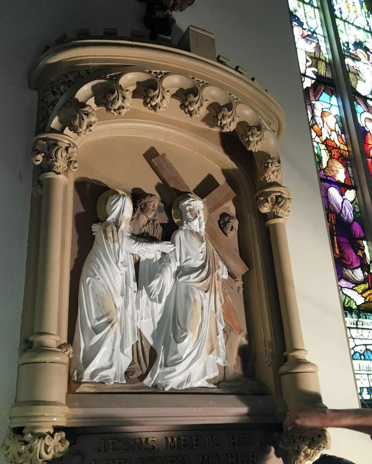 The Fourth Station, Jesus meets his mother, before the restoration. The 14 Stations of the Cross on the walls of the Church of Assumption in Ansonia, Conn. have been meticulously restored to their original luster.