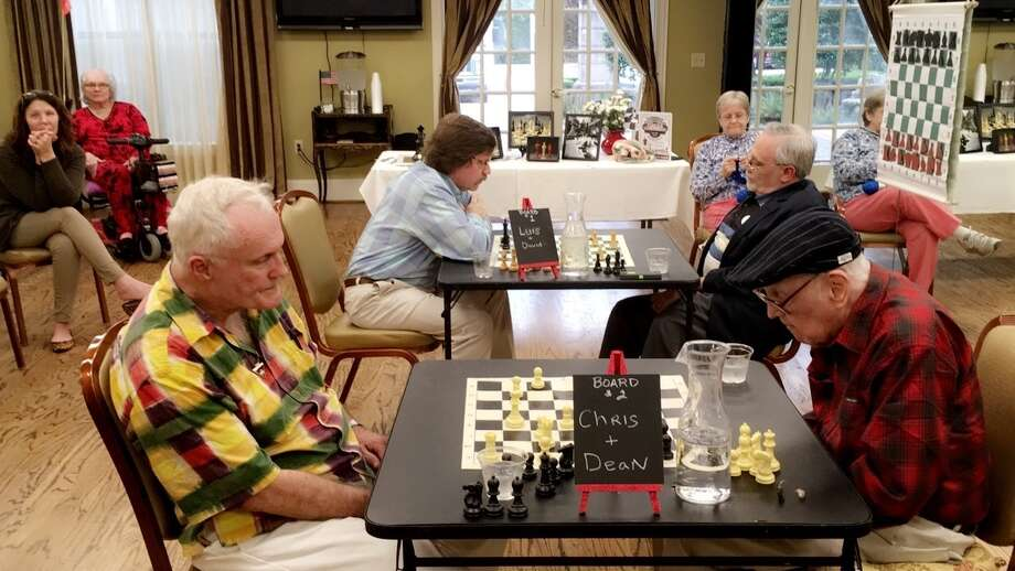 Chess is a popular activity for male residents at The Conservatory at Alden Bridge. Photo: Courtesy Of The Conservatory At Alden Bridge