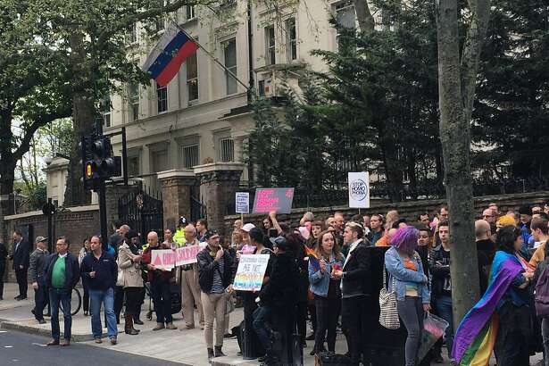 People protest outside the Russian Embassy in London, following reports of the torture and murder of gay men in Chechnya, Wednesday April 12, 2017. The United Nations� High Commissioner for Human Rights called upon the Russian government in a statement �to put an end to the persecution of people perceived to be gay or bisexual, while Chechen authorities denied the reports, and spokesman for leader Ramzan Kadyrov insisted there were no gay people in Chechnya. (Thomas Hornall/PA via AP)