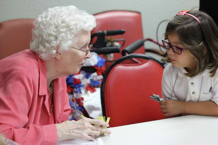 Youngest volunteer Olivia, age 6½, interacts with Treemont resident Carmin Cleavenger, a former school teacher who adores Olivia.
