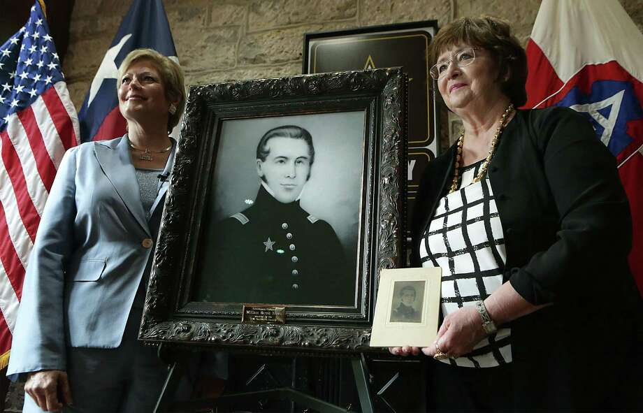Sally Ann Mauck (right) and Jeanie Travis, who both have lineal ties to the family of William Barret Travis, hold a portrait of the famed Alamo commander in a 2015 photo at Fort Sam Houston. Mauck presented two copies of the portrait to U.S. Army North, one which will be on display in the Texas Room at the Historic Quadrangle at Ft. Sam Houston, the other in the Travis House, an officer's residence on the Post. Travis biographer Bob Sanders believes the little-known image by an unknown artist, may be the most accurate likeness of the Alamo commander. Photo: Bob Owen /San Antonio Express-News / San Antonio Express-News