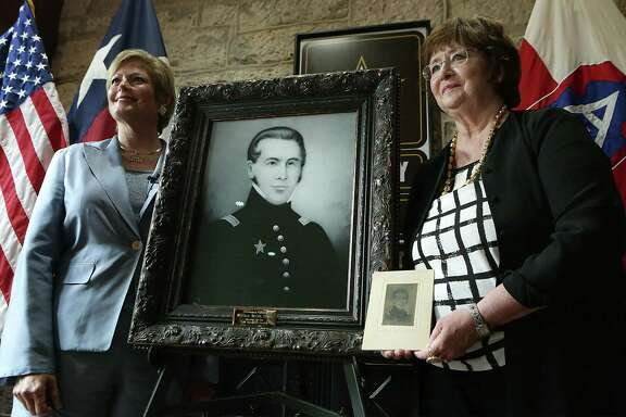 Sally Ann Mauck (right) and Jeanie Travis, who both have lineal ties to the family of William Barret Travis, hold a portrait of the famed Alamo commander in a 2015 photo at Fort Sam Houston. Mauck presented two copies of the portrait to U.S. Army North, one which will be on display in the Texas Room at the Historic Quadrangle at Ft. Sam Houston, the other in the Travis House, an officer's residence on the Post. Travis biographer Bob Sanders believes the little-known image by an unknown artist, may be the most accurate likeness of the Alamo commander.