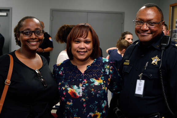 Veronica Durden, Karen Moore and Maj. Marlon Lewis at a swearing-in and promotion ceremony for the Jefferson County Sheriff's Office on Thursday.  Photo taken Thursday 4/13/17 Ryan Pelham/The Enterprise