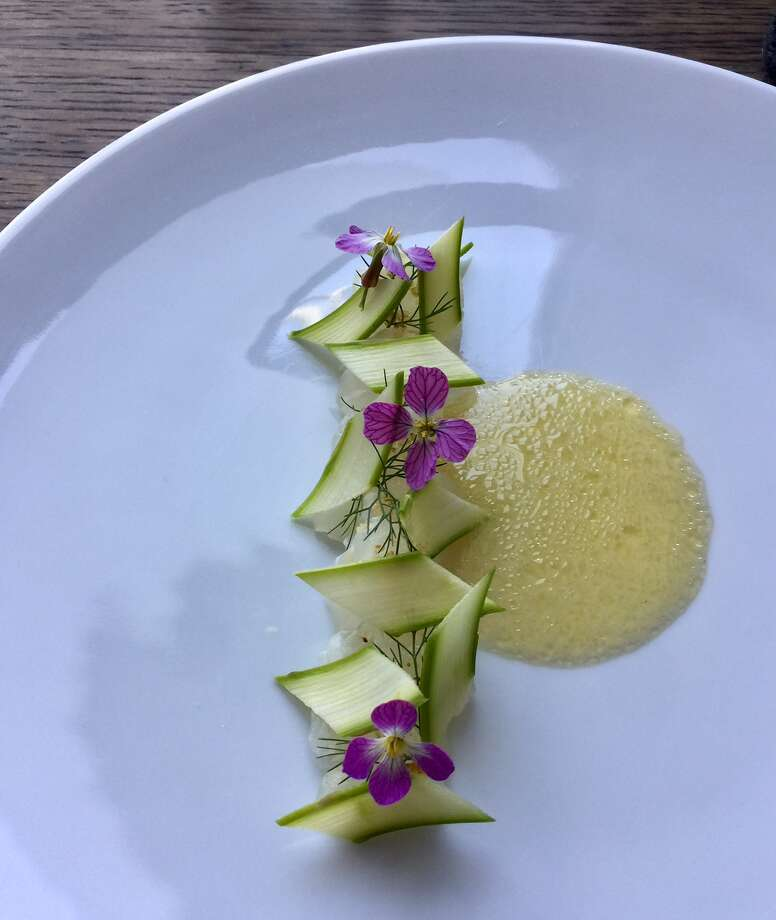 Commis, Oakland: One of the 12-courses on the $149 menu features salted spring flounder with bay laurel blossoms and elderflower vinegar and safflower Photo: Michael Bauer / SF Chronicle